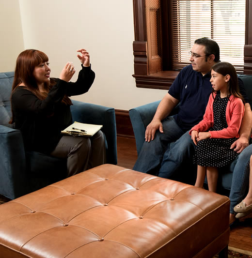 Counselor conducts session with a family